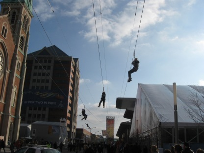 January 27th: Super Bowl XLVI fans zipline over Capitol Street in downtown Indianapolis.