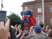 June 9th: At the annual Superman Celebration in Metropolis, IL, actors John Glover and Cassidy Freeman pose by the town's famous Superman statue for hundreds of townspeople, fans, and Internet users.