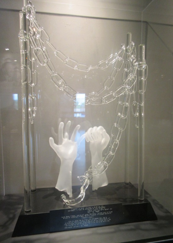 glass hands and chains.
