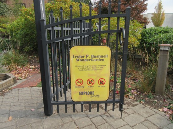 "The gate to WonderGarden advises guests ""Explore Gently""."