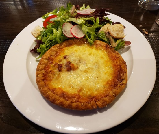 Bacon and Leek Quiche with mixed greens salad.