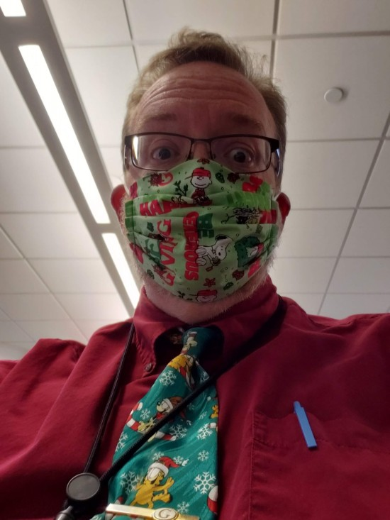 me wearing a Christmas Mask.