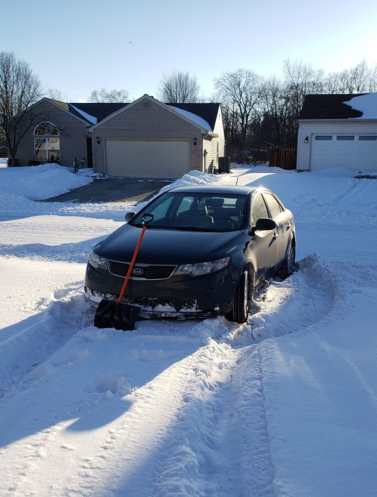 My car, stuck at the foot of our stupid driveway.